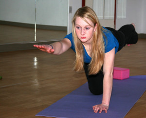 Girl doing yoga class
